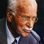 ca. 1950-1961 --- Swiss psychiatrist Carl Gustav Jung (1875-1961) smoking a pipe. He is known as the founder of analytical psychology. --- Image by © Bettmann/CORBIS
